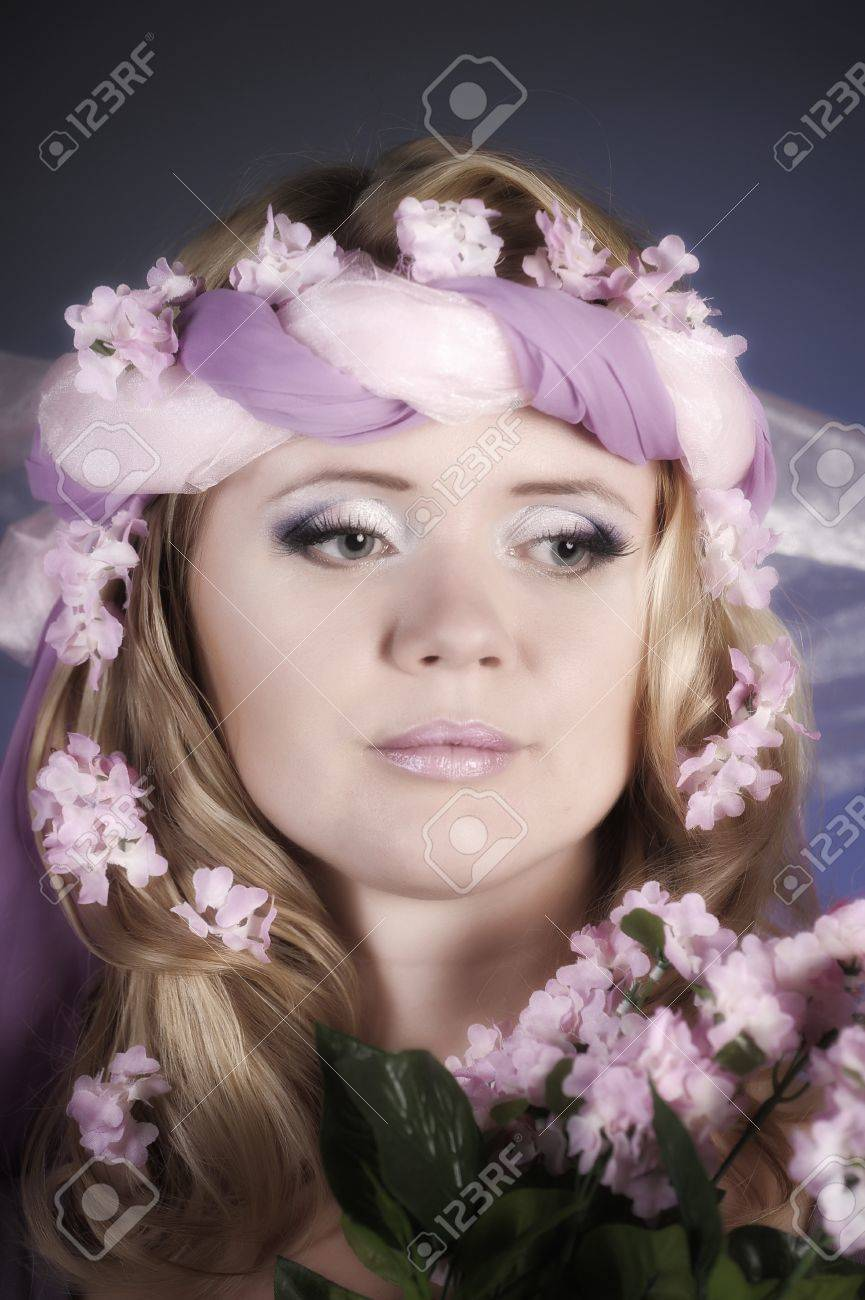 The flower fairy with lilacs Stock Photo - 11936671