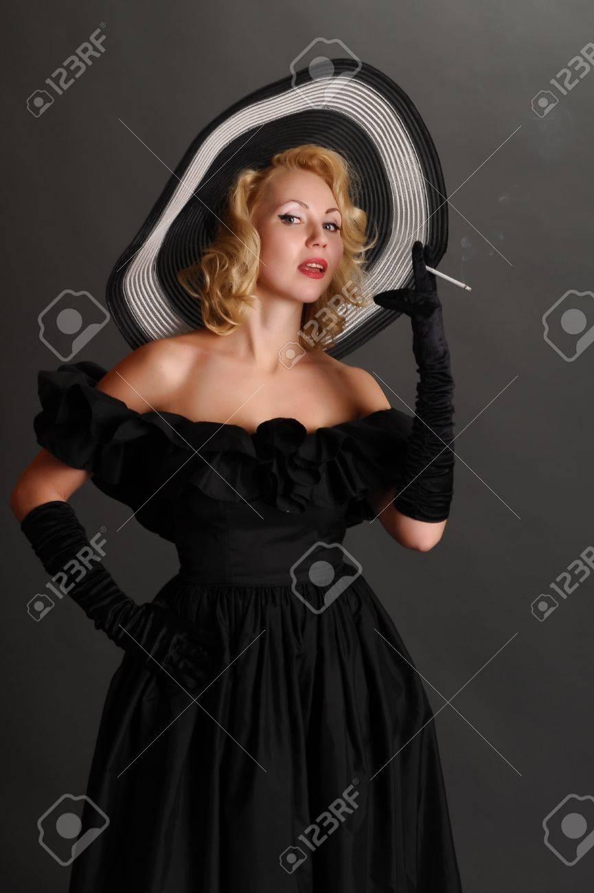 elegant woman in a hat smoking Stock Photo - 12234742