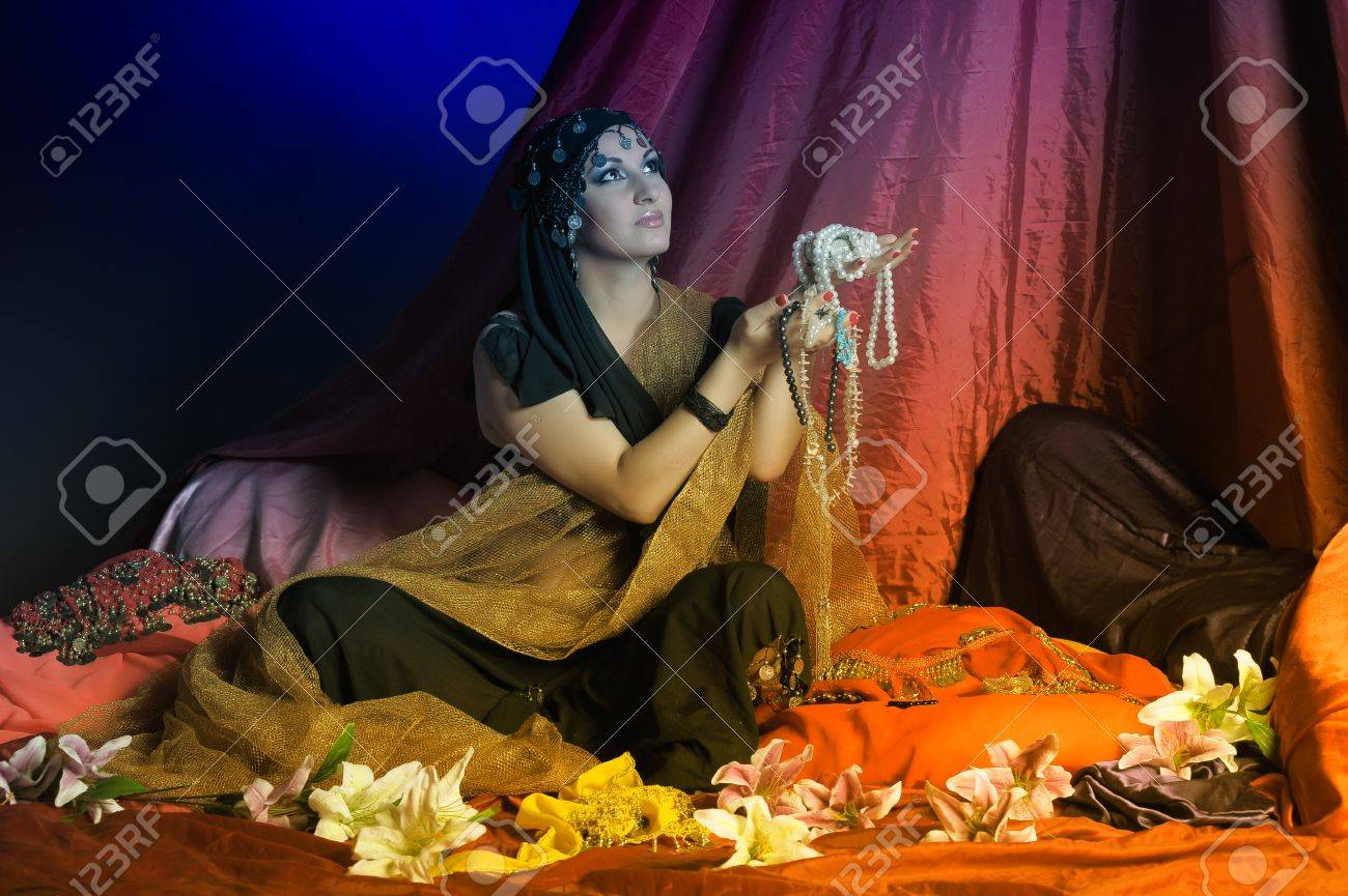 Shot of an oriental woman in a traditional costume Stock Photo - 11963647