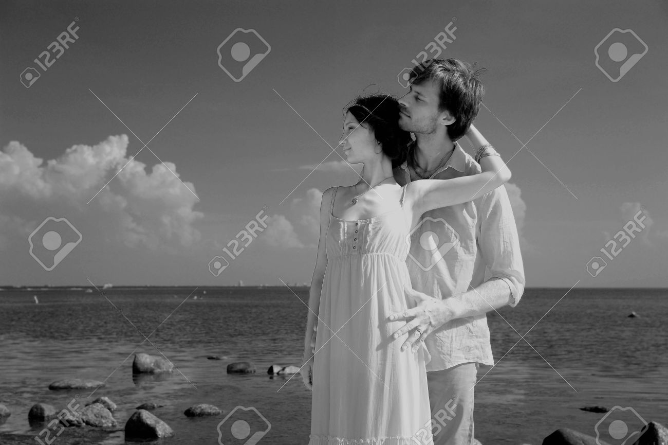 young couple in love on the shore, retro Stock Photo - 11960785