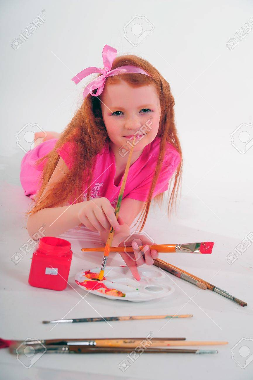 girl with brushes in hand Stock Photo - 12026269
