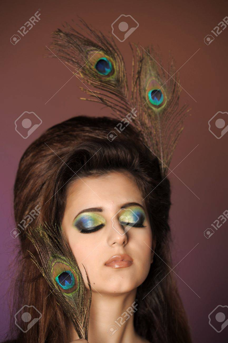 Portarit of beautiful young girl with peacock feather Stock Photo - 13280989