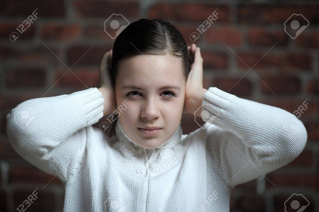 girl  with his hands covering his ears Stock Photo - 12160822
