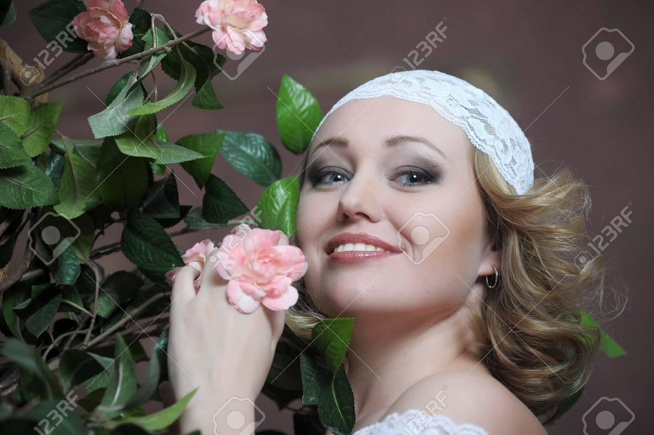 Retro portrait of Pretty woman with roses Stock Photo - 12182770