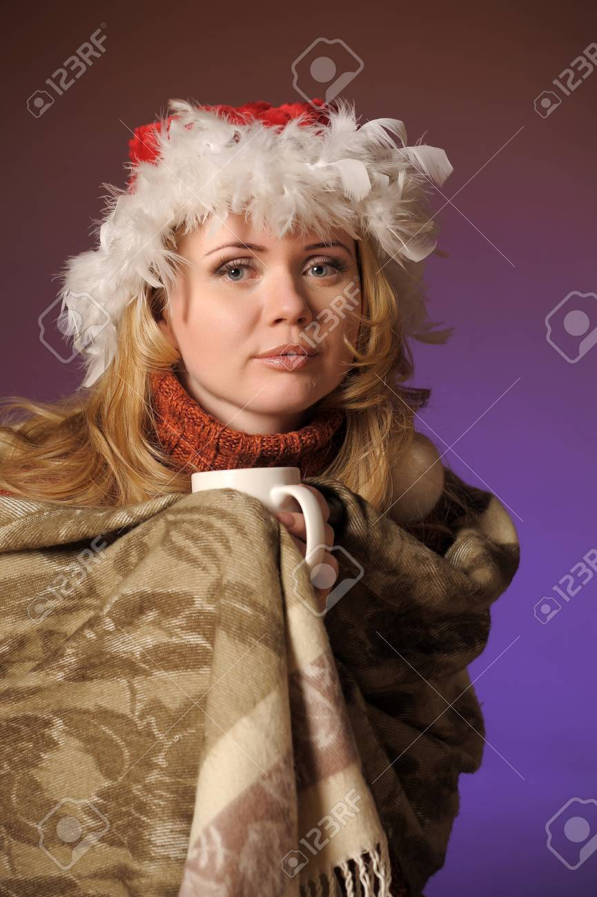 Young woman with santa hat holding a cup Stock Photo - 13236083