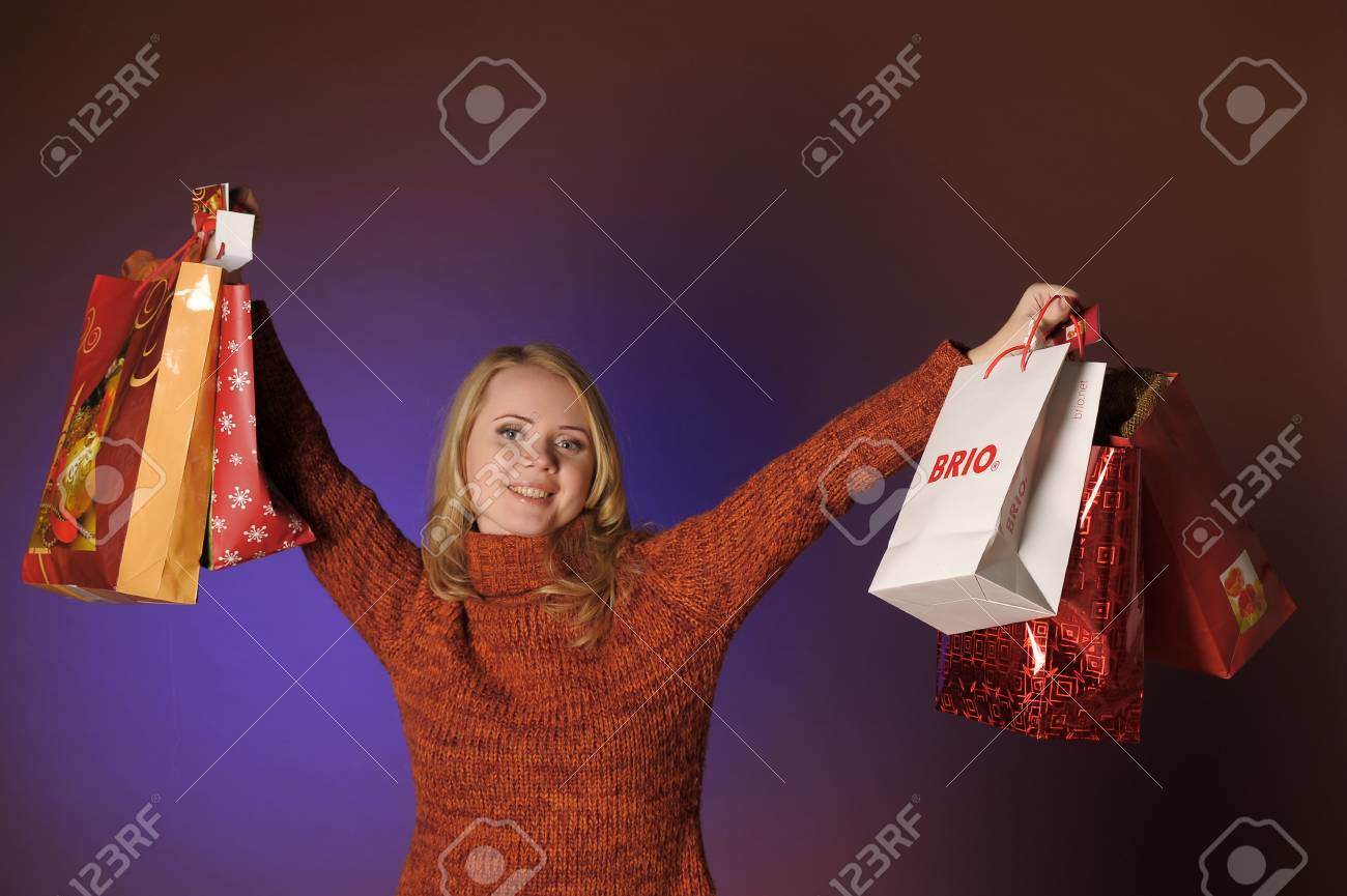 The young woman with gifts Stock Photo - 13039235
