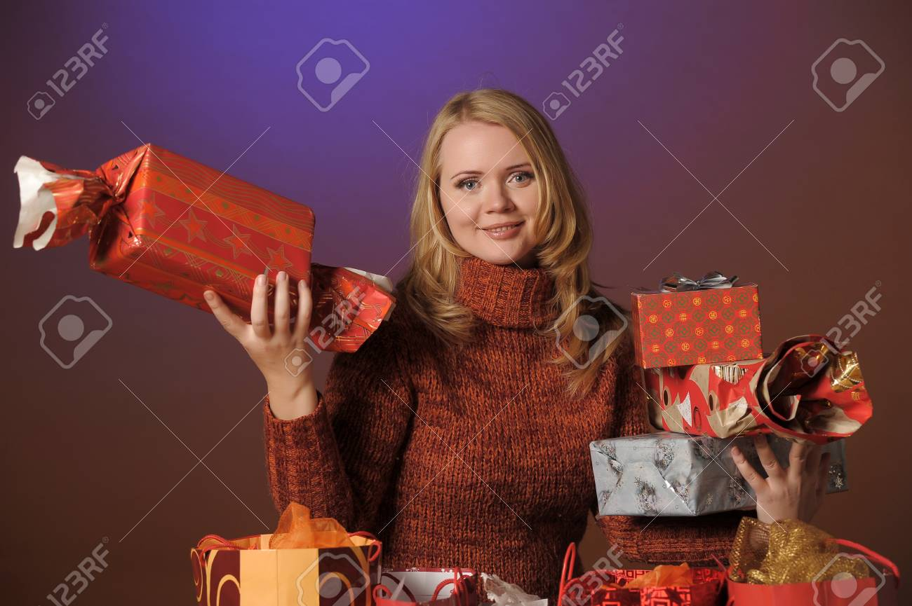 The young woman with gifts Stock Photo - 13039224