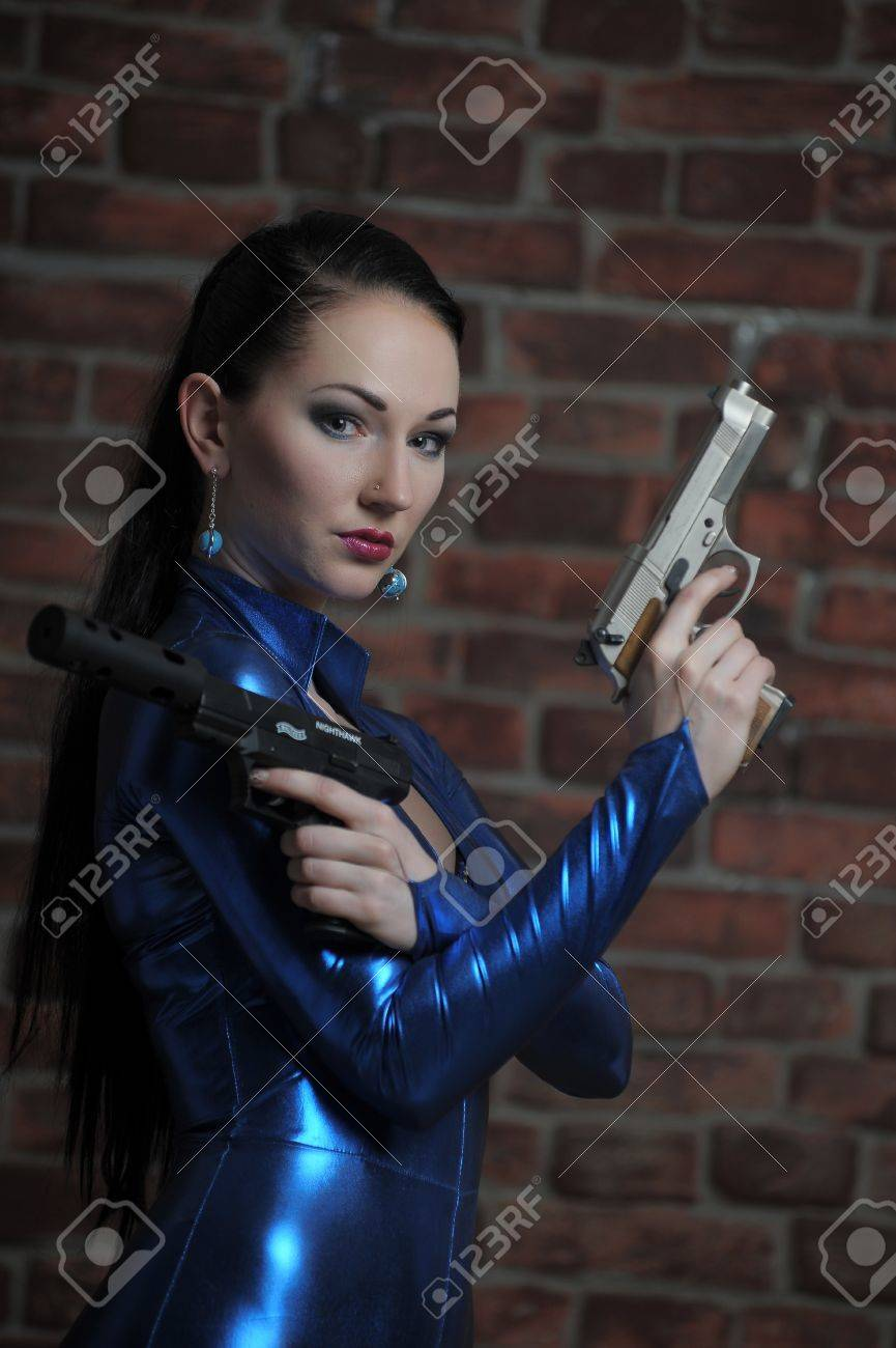 Martial young lady with gun Stock Photo - 12233507