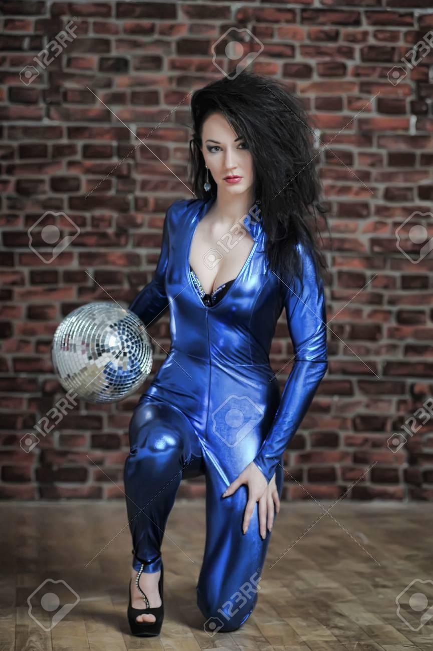 Disco girl with mirror ball Stock Photo - 12233527
