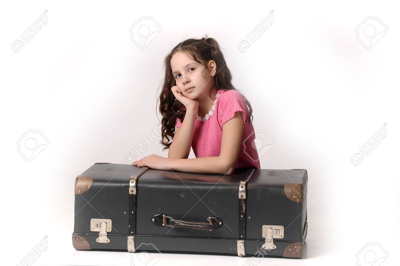 teen girl with a suitcase Stock Photo - 14165409