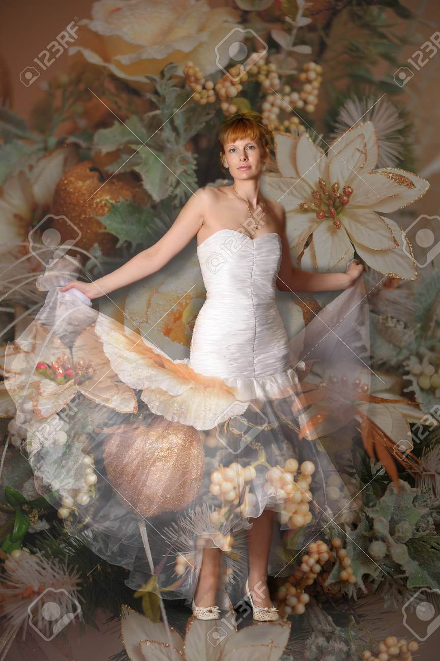 Young woman wearing wedding dress Stock Photo - 13252452