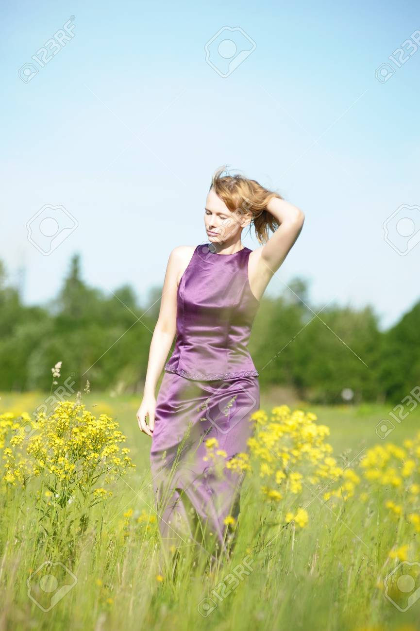 young woman in a field of yellow flowers Stock Photo - 12234508