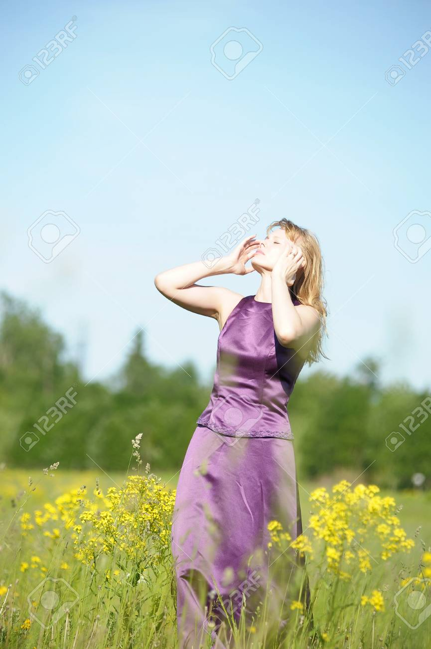 young woman in a field of yellow flowers Stock Photo - 12234514