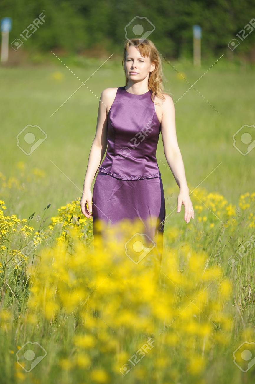 young woman in a field of yellow flowers Stock Photo - 12234569