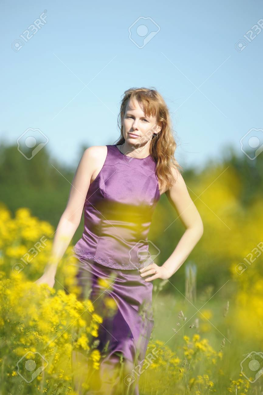 young woman in a field of yellow flowers Stock Photo - 12234507