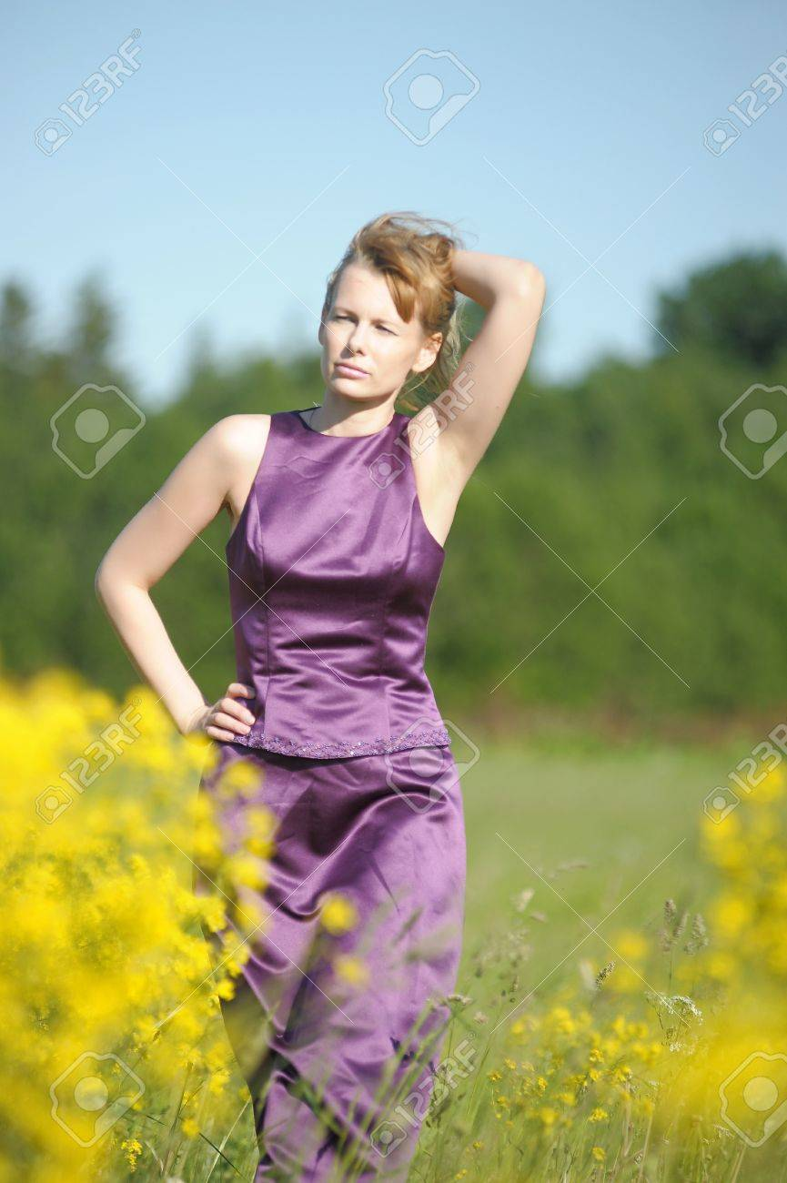 young woman in a field of yellow flowers Stock Photo - 12234511