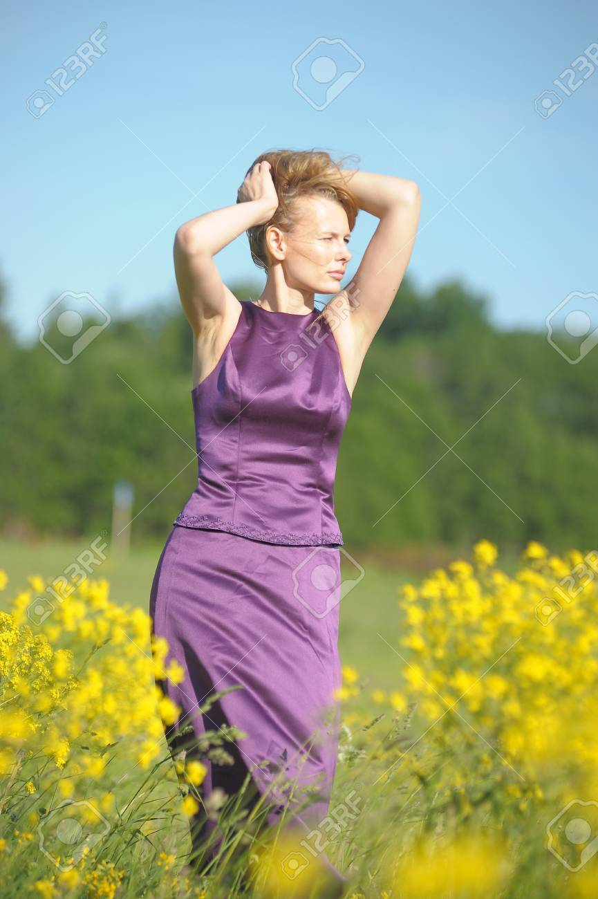 young woman in a field of yellow flowers Stock Photo - 12234521
