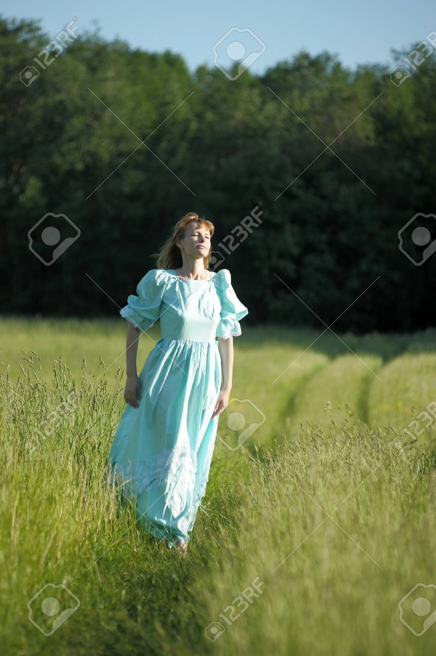 young woman in an retro dress in the field Stock Photo - 12234568