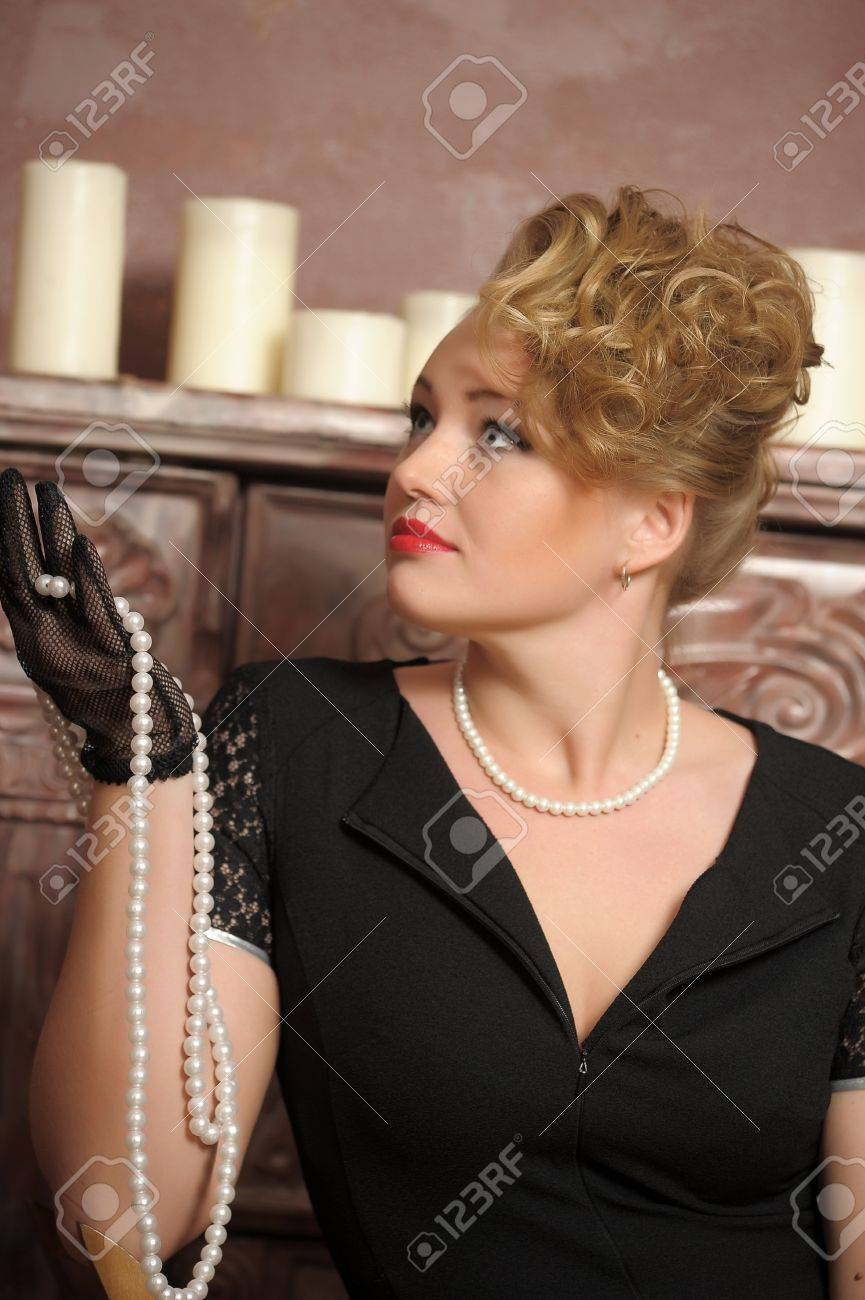 Stock Photo  Retro Photo Woman With A Black Dress With Pearl Necklace In  Hand