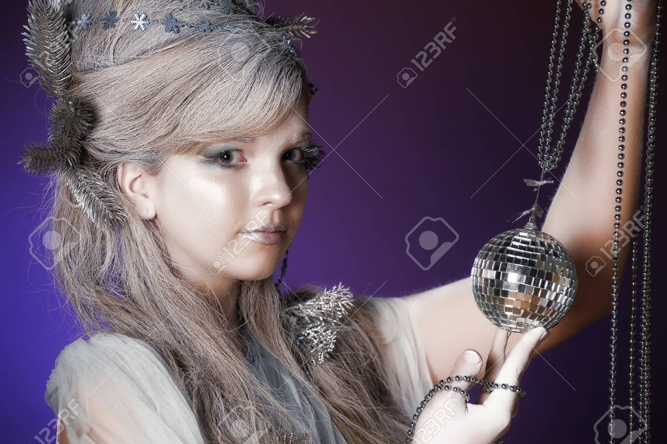 portrait of a girl with a mirror ball in his hands Stock Photo - 14166356
