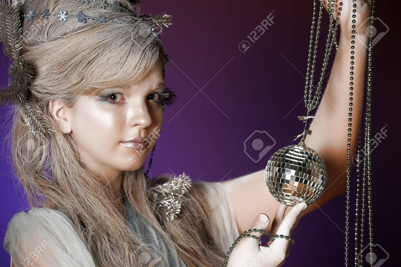 portrait of a girl with a mirror ball in his hands Stock Photo - 14166354