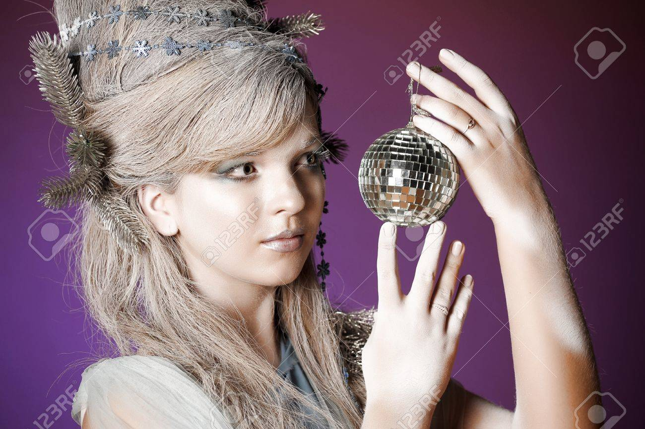 portrait of a girl with a mirror ball in his hands Stock Photo - 14166587