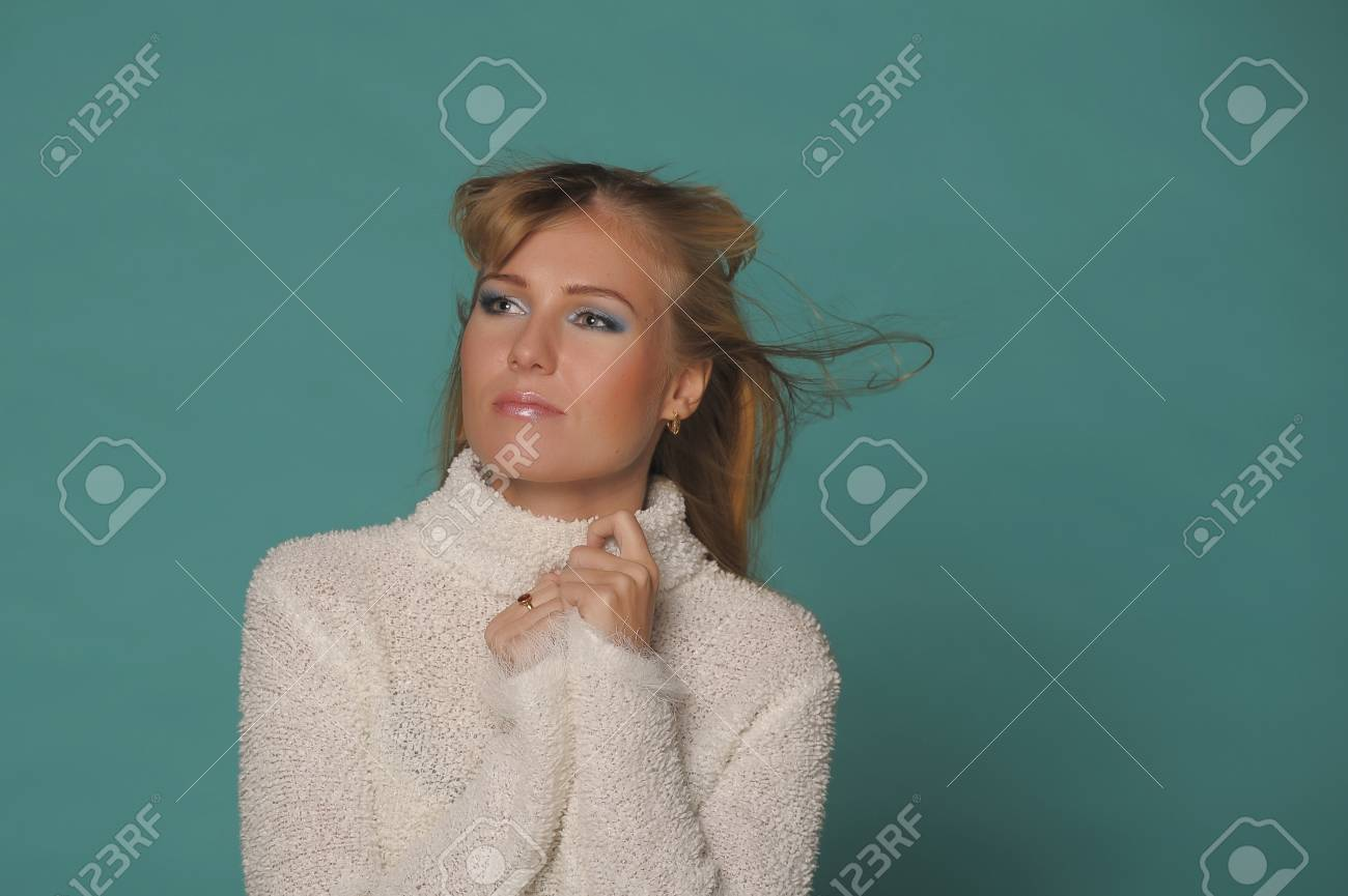beautiful blonde in a white sweater Stock Photo - 17890637