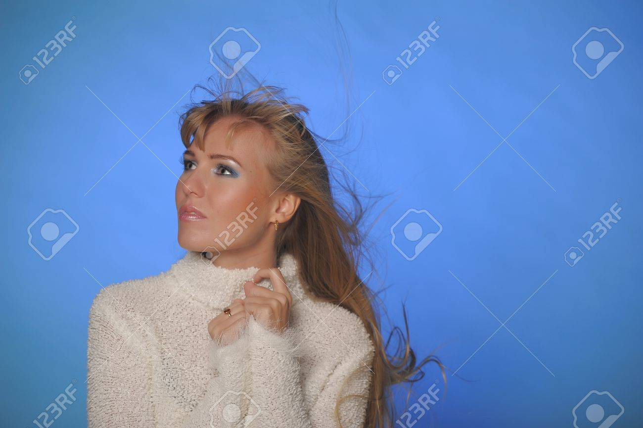 beautiful blonde in a white sweater Stock Photo - 17890671