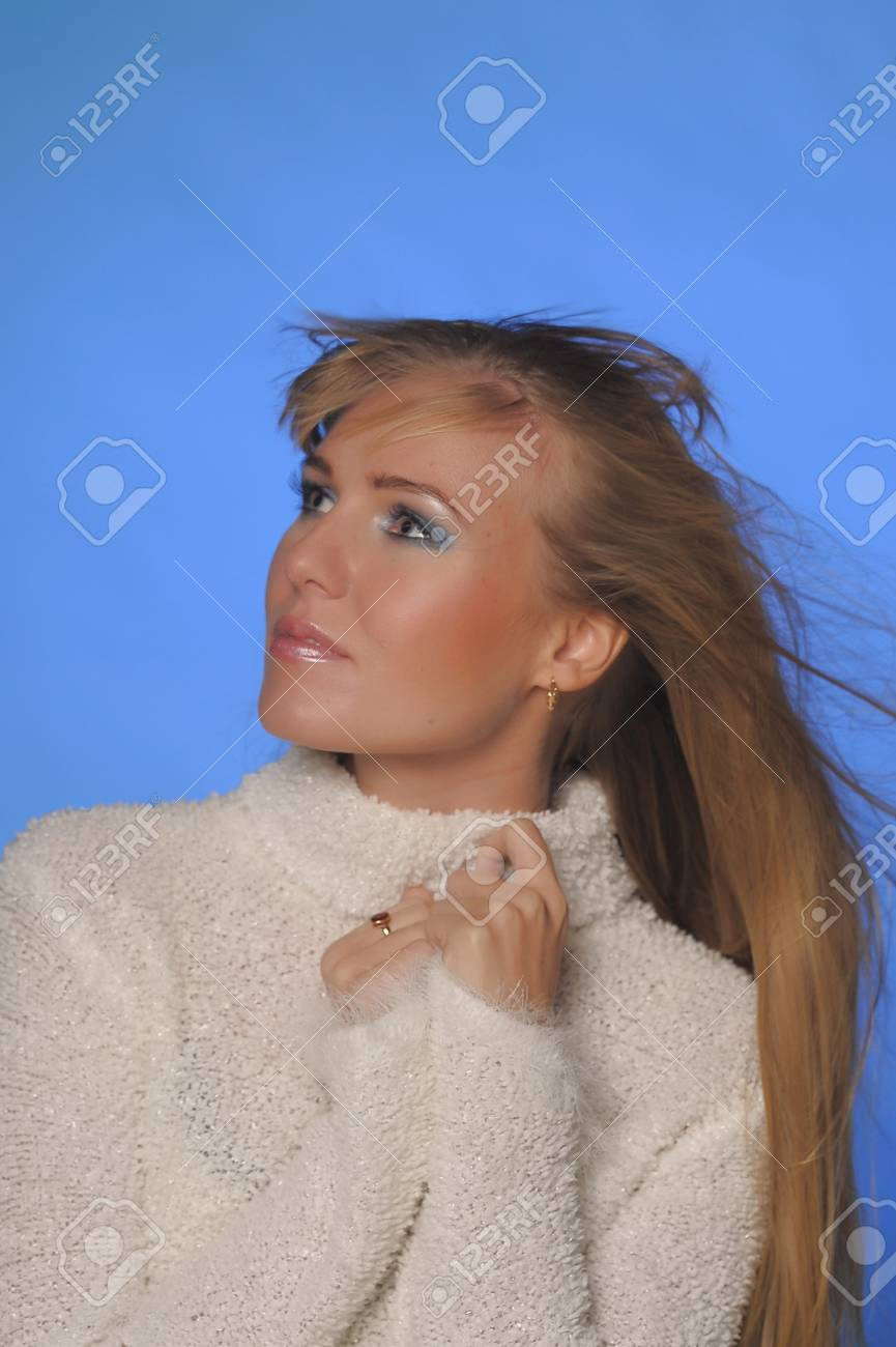 beautiful blonde in a white sweater Stock Photo - 17890569