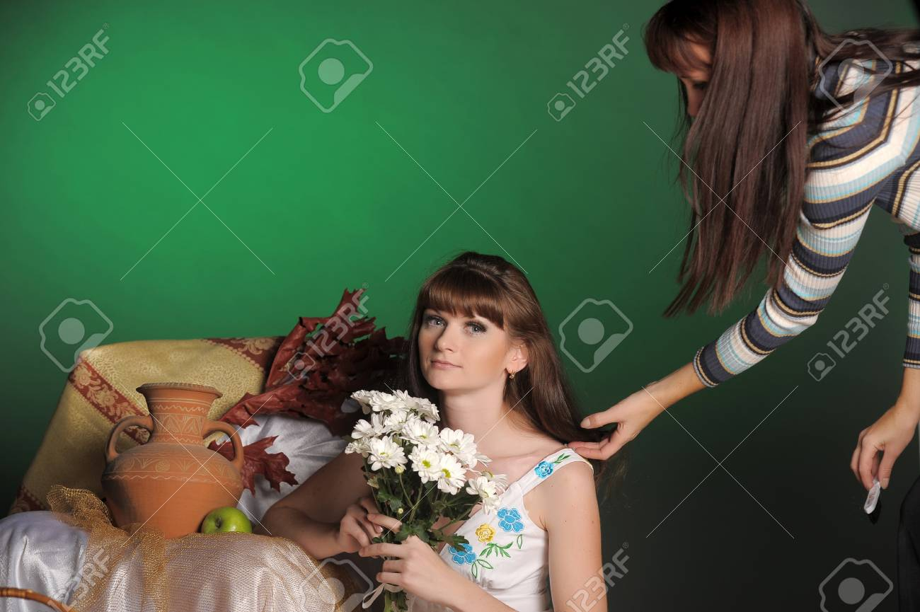 the stylist corrects models a hairdress in studio before shooting Stock Photo - 13252627