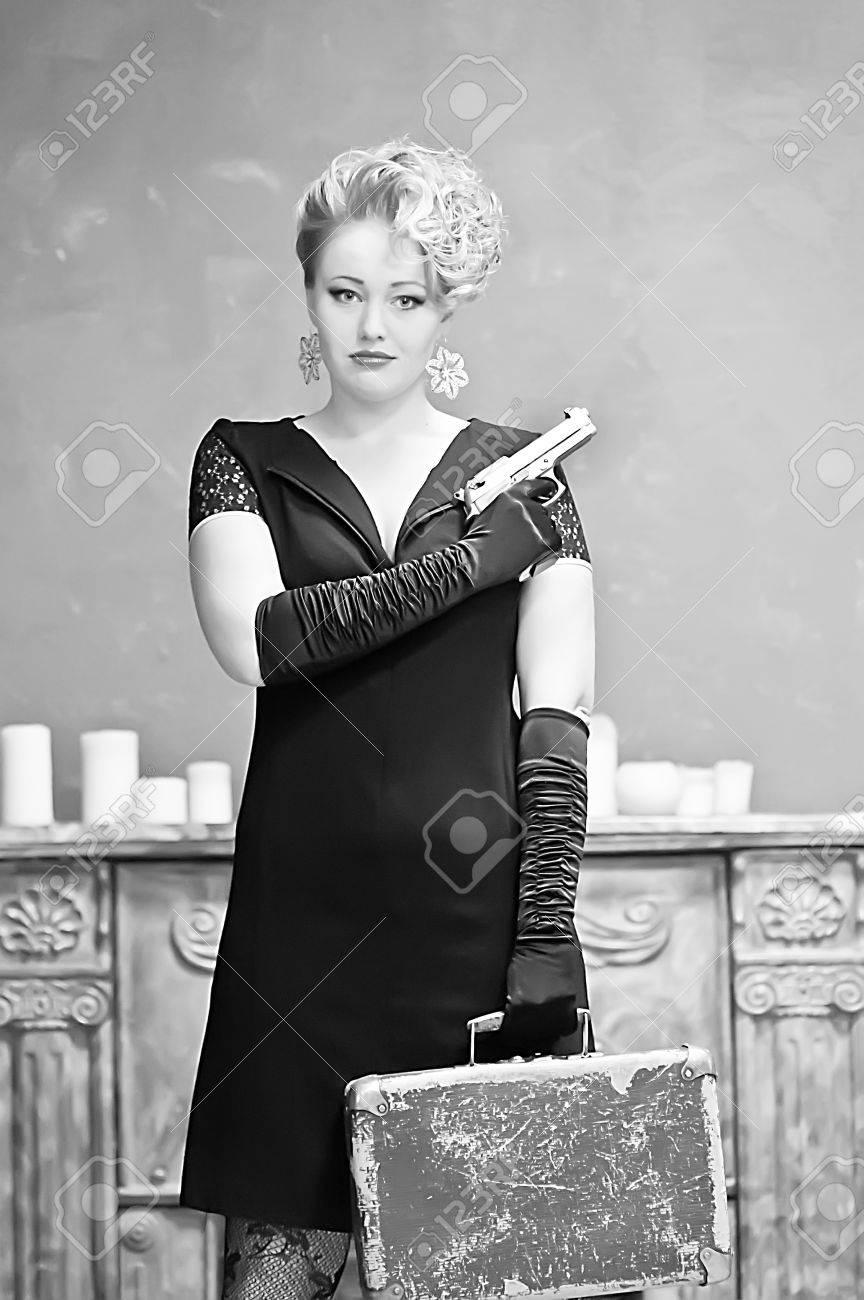 Blonde holding a gun Stock Photo - 13252652