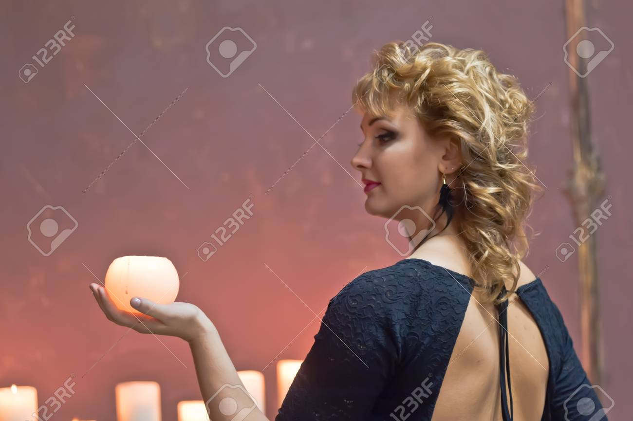 Studio picture of a young woman with candles Stock Photo - 15109634