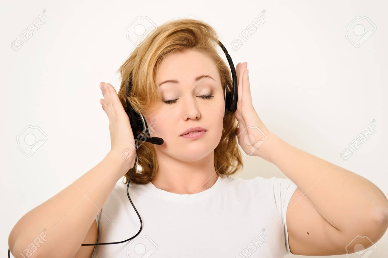 Woman with a Headset Stock Photo - 12443060