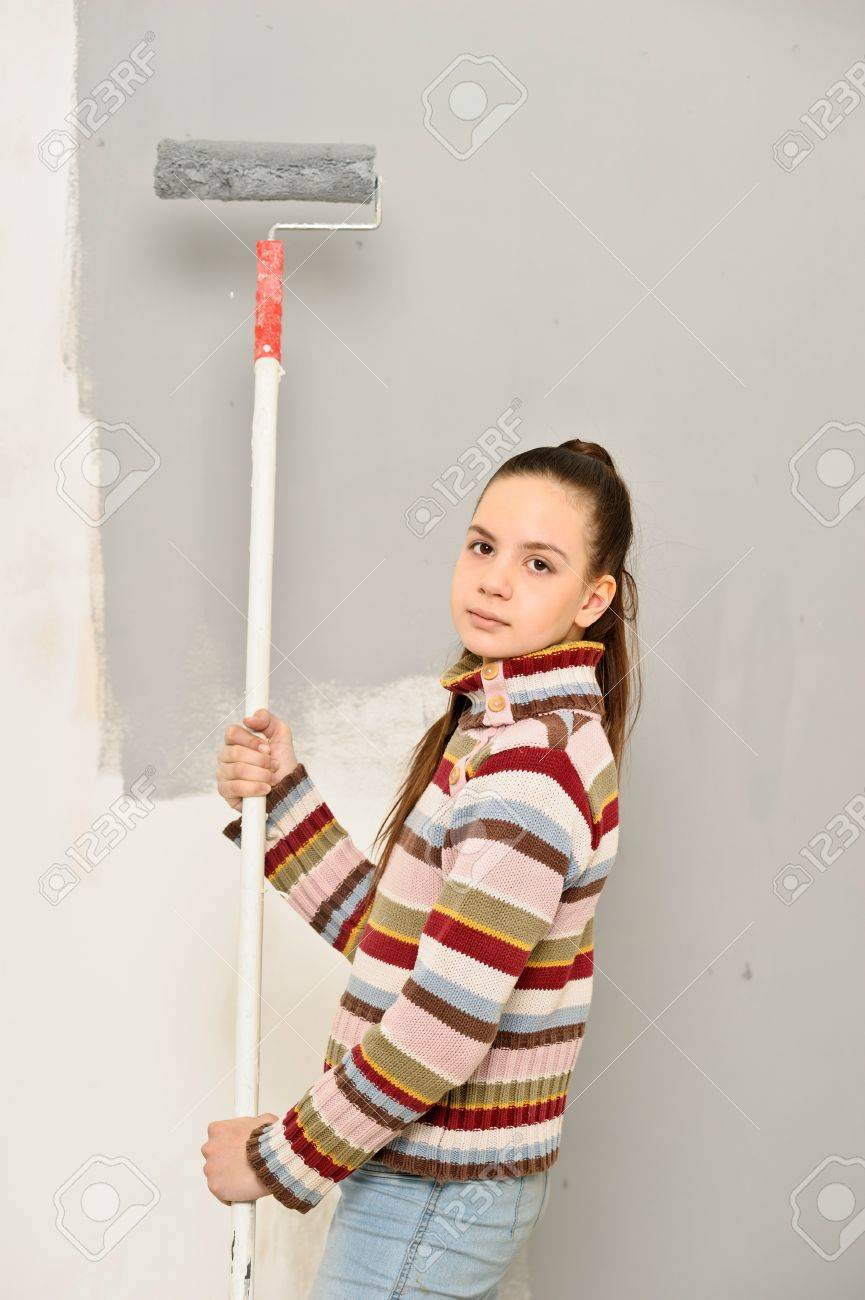 The girl is the house painter Stock Photo - 12676157