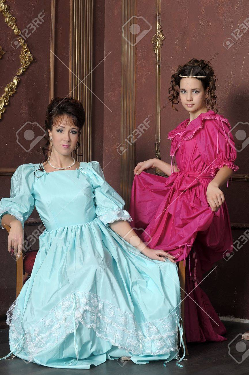 Two ladies in medieval dresses Stock Photo - 13280634