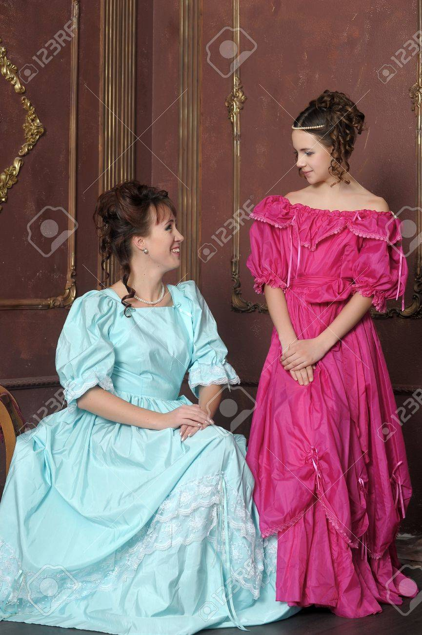 Two ladies in medieval dresses Stock Photo - 13280573