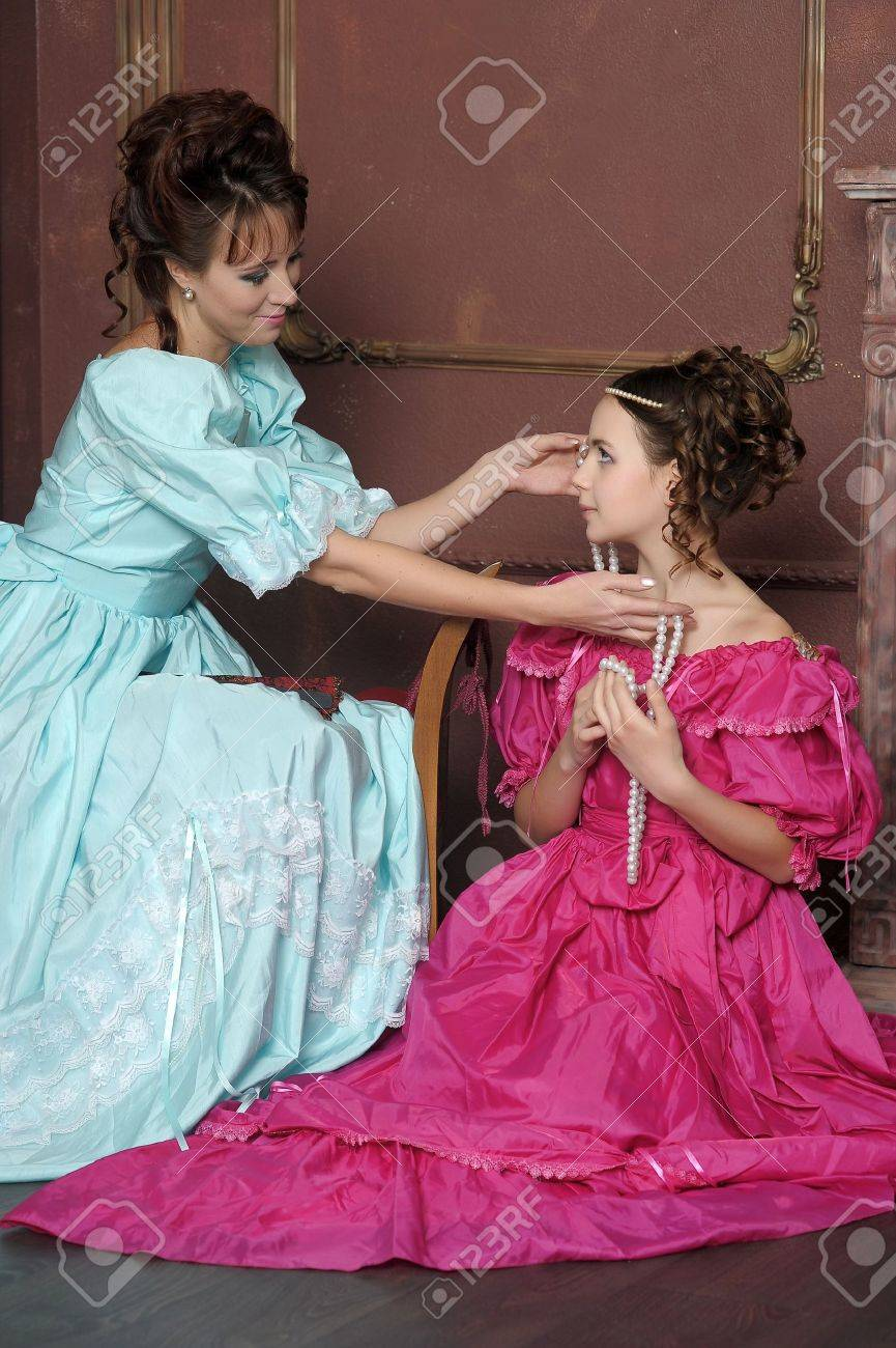 Two ladies in medieval dresses Stock Photo - 13280575