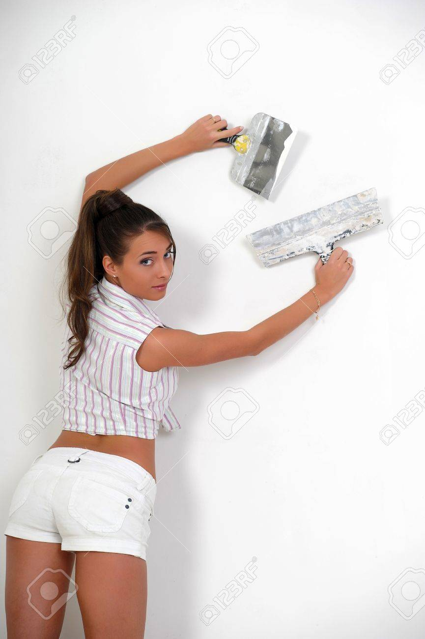 Girl plastering the wall Stock Photo - 12676084