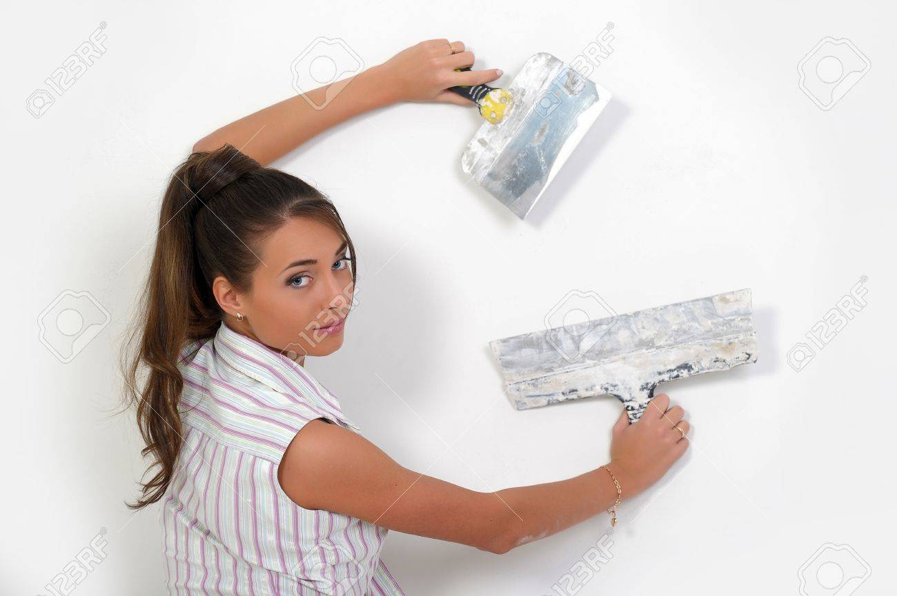 Girl plastering the wall Stock Photo - 12676089