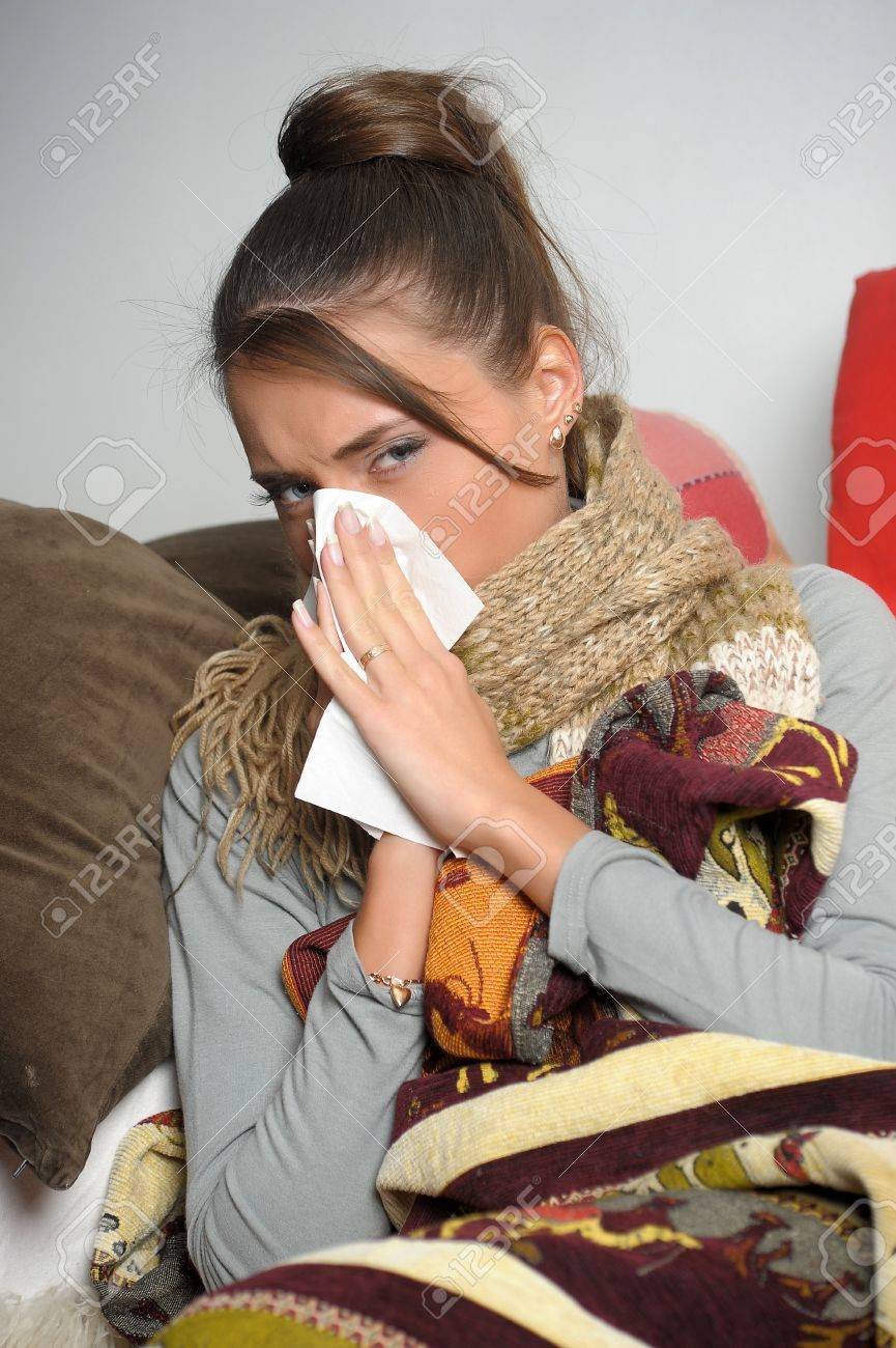 Young woman is ill in bed  She is feeling miserable Stock Photo - 12588084
