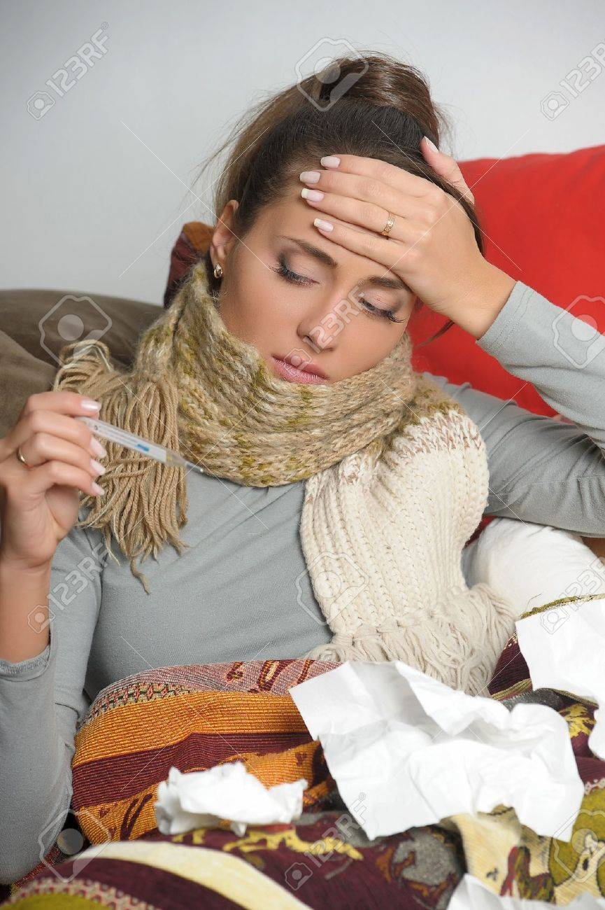 Sick woman lies in a house bed Stock Photo - 12669187