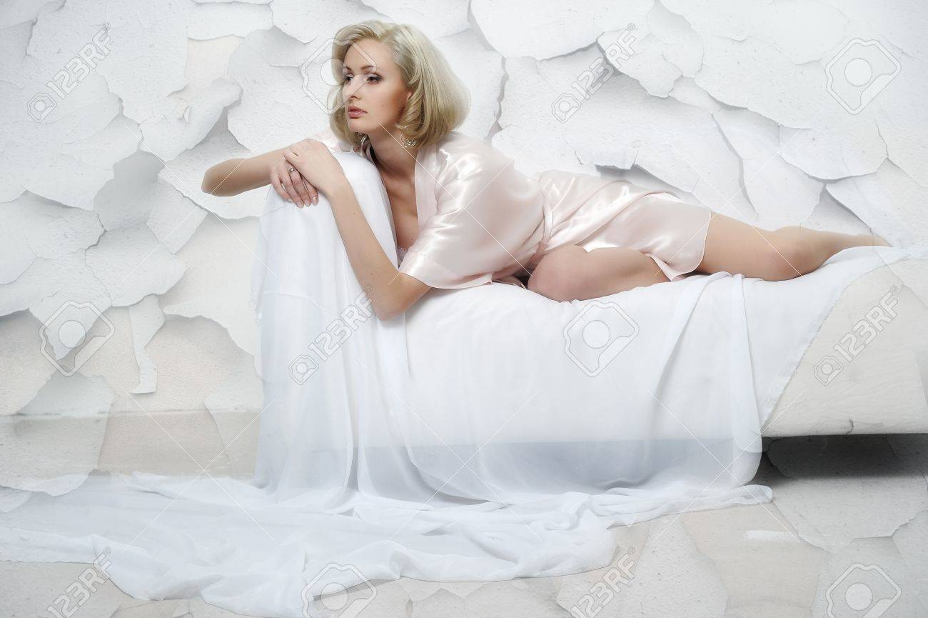 sexy blonde in a negligee Stock Photo - 13931854