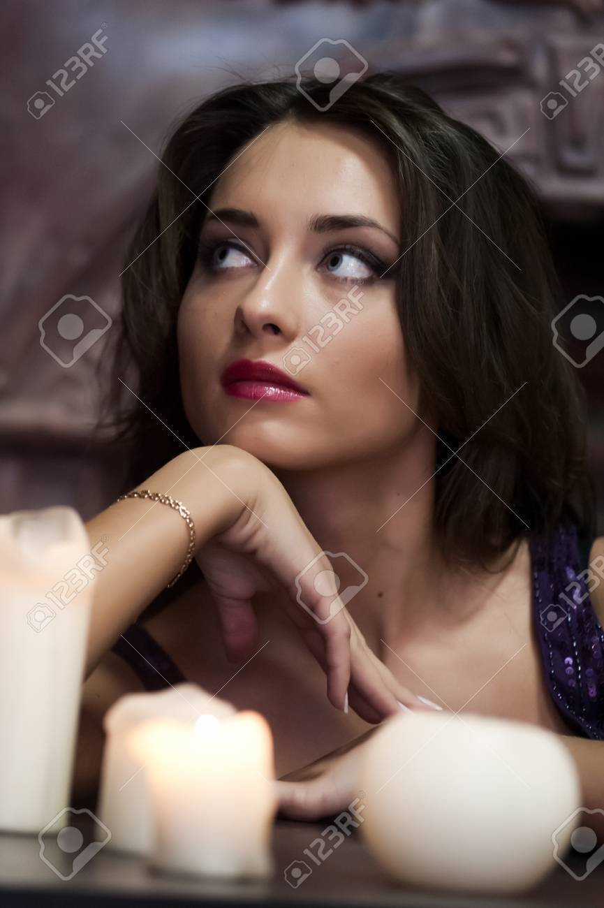 the beautiful brunette with candles Stock Photo - 13280740
