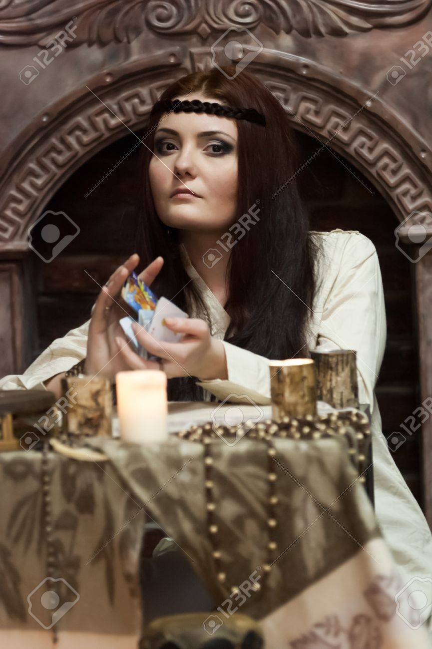 woman with cards and candles Stock Photo - 18434704