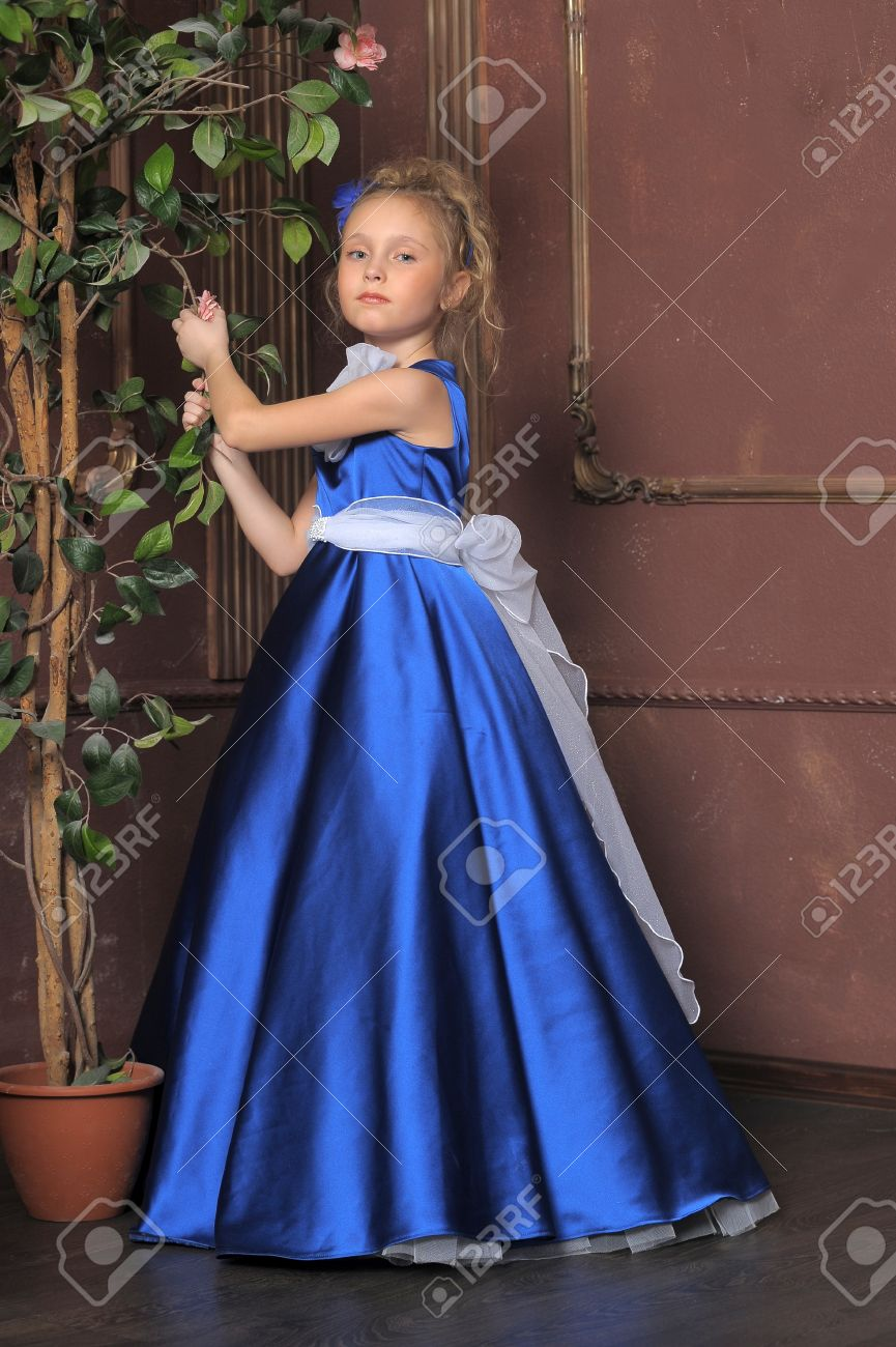 Little Girl Looks Like A Small Princess In Beautiful Blue Dress ...