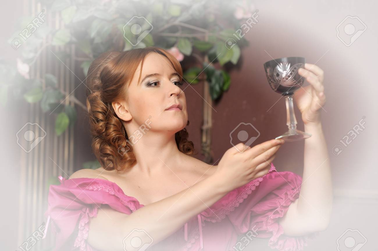 portrait of the woman in a medieval dress with a glass in hands Stock Photo - 13153636