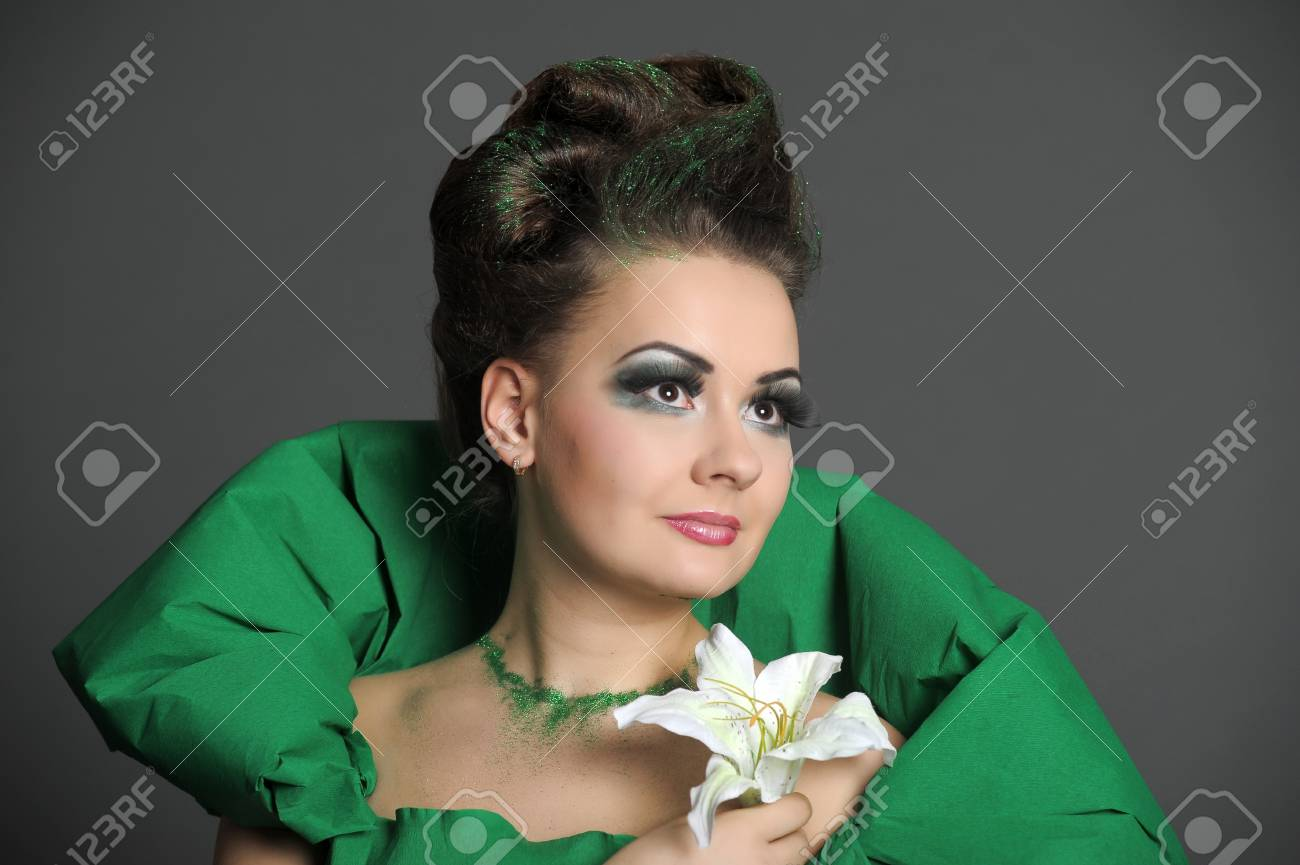 girl in a green dress with a lily Stock Photo - 16114106