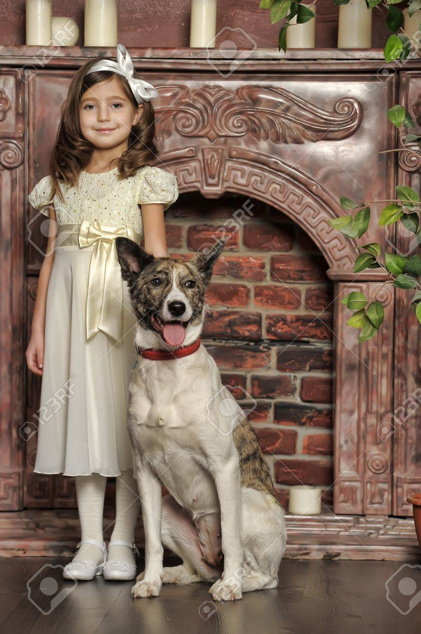 Vintage portrait of a little girl with dog Stock Photo - 13146501