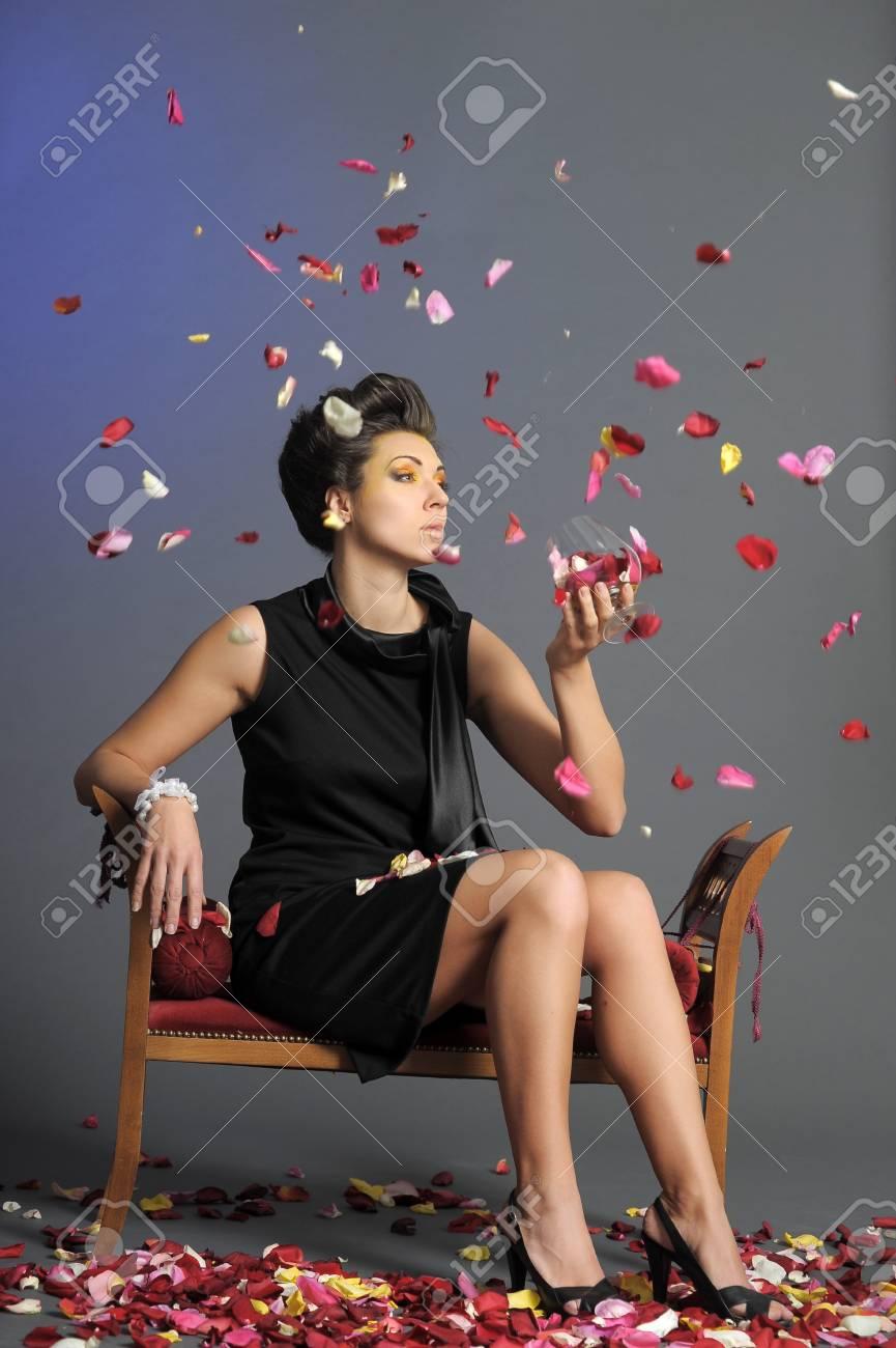 Beautiful girl  with rose petals Stock Photo - 13157739