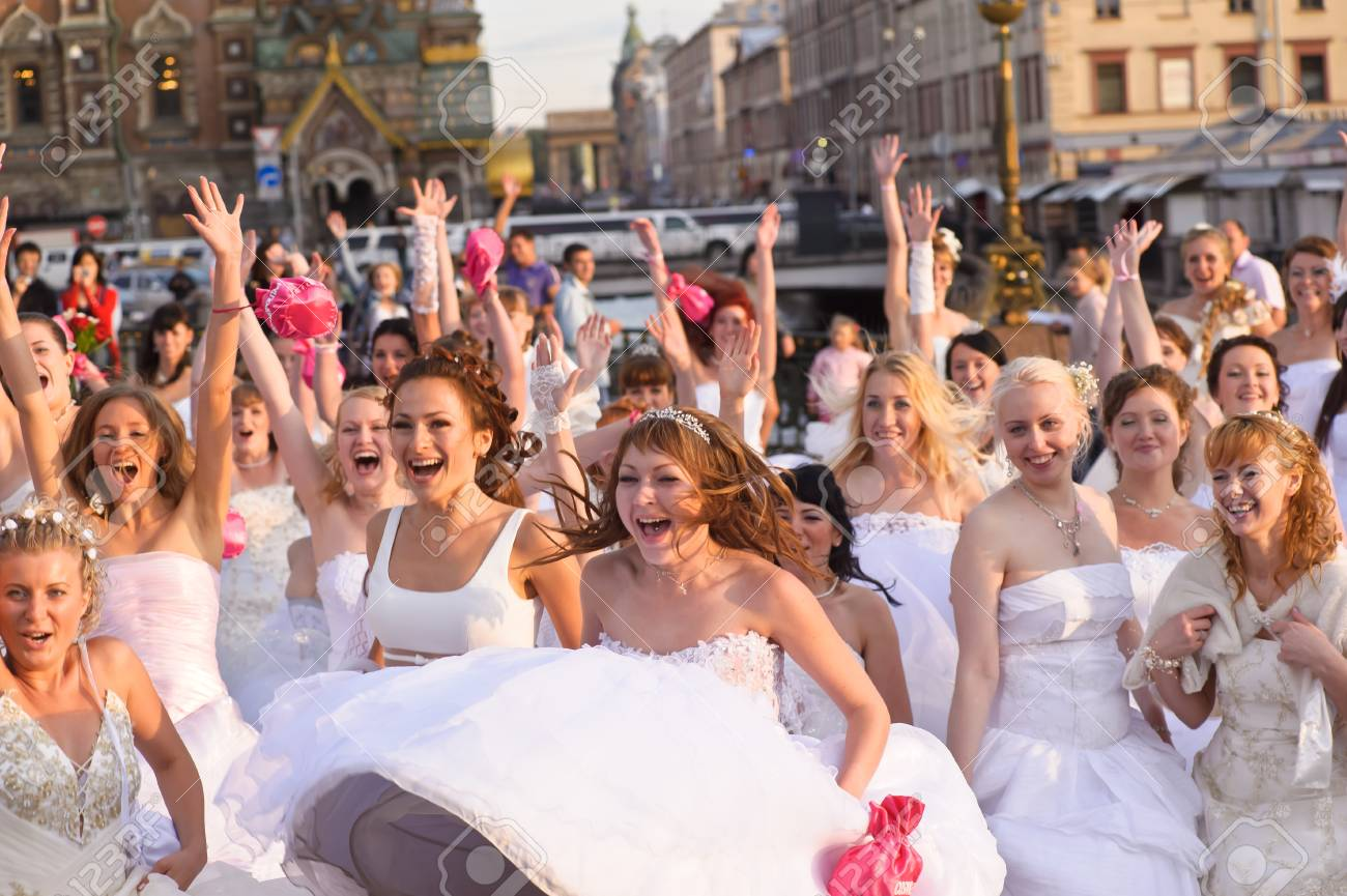 Action «Run-away brides of Cosmopolitan» — a flashmob of long-distance scale which was spent the seventh year.  Russia, St. Petersburg Stock Photo - 13337896